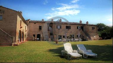 Ref. 5454 Bricks Farmhouse in Siena with Pool and Land.