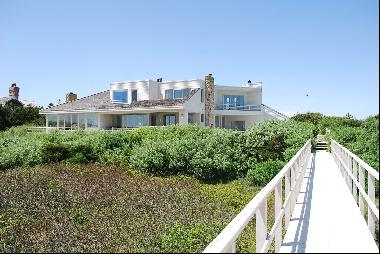 Nestled between the Atlantic Ocean and Shinnecock Bay sits this Modern Masterpiece on almo