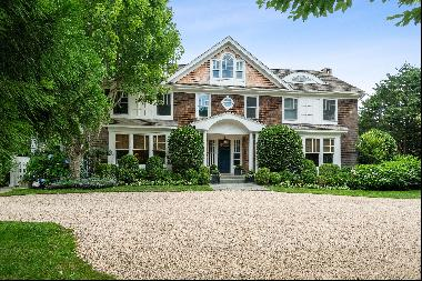 This impeccable, eight-bedroom, six and one half-bath home has a gourmet kitchen, formal d