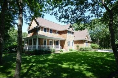 Enjoy your summer in this four-bedroom, three and a half-bath home on almost 1-acre. Manic