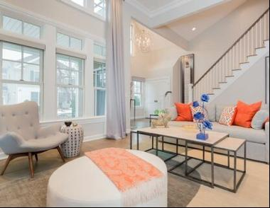 Designer six bedroom townhome in Bishops Pond. Master on first level. Features an open flo