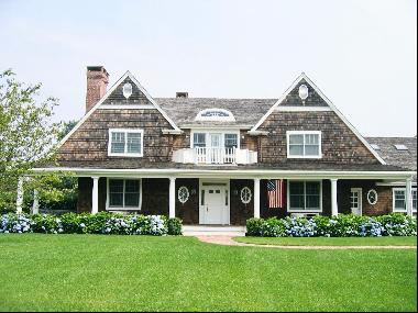 Located in Southampton Village on 1.2 +/- acres on a quiet cul-de-sac, this beautiful ceda