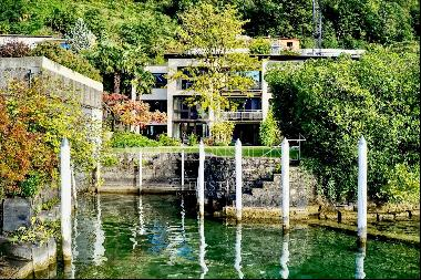 Exclusive terraced villa directly on Lake Lugano with dock & boat mooring for sale