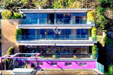 Melide: modern penthouse apartment with a magical view of Lake Lugano for sale