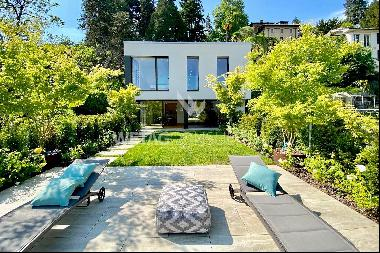 Modern villa in Porza for sale with sweeping view, partially on Lake Lugano