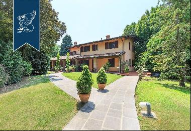 Elegant estate for sale with vast agricultural grounds in Lombardy