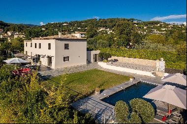 Modern villa located within a gated domain.