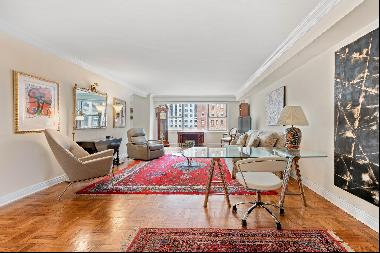 LIVE GRACIOUSLY IN THIS EXPANSIVE CONVERTIBLE 3 BEDROOM CO-OP IN PRIME MIDTOWN! Open city