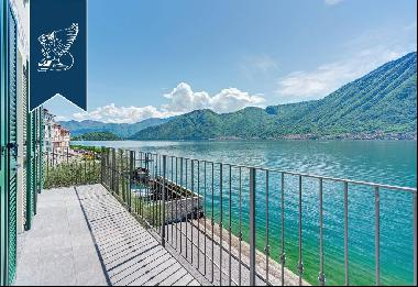 refined lake-front estate with big panoramic terraces over the surroundings