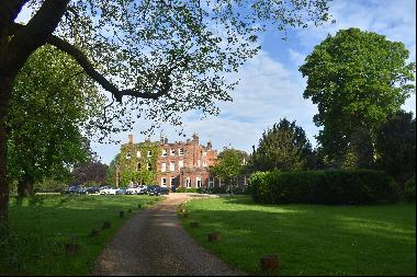 A 3 bedroom home forming part of Ayot House. Set within parkland  with garaging and commun