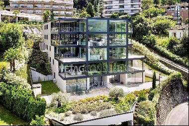 Modern city apartment with terrace & view over Lake Lugano for sale in Paradiso