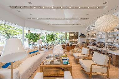 The general design inspiration for this space is Mies Van Der Rohe at the beach. The large