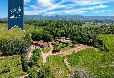 Agricultural farm with recently-renovated resort among the sweet rolling Chianti hills