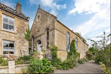 A unique 3 bedroom semi-detached former chapel, with beautiful stained glass windows and a