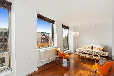 Enjoy open views of the East Village and Lower East Side from this 5th floor home. This ve