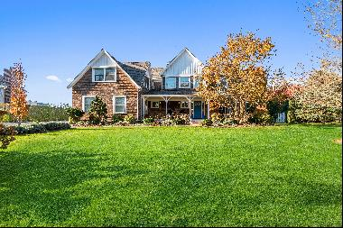 Enjoy sunsets over the farmland views from the lovely screened-in porch of this five bedro