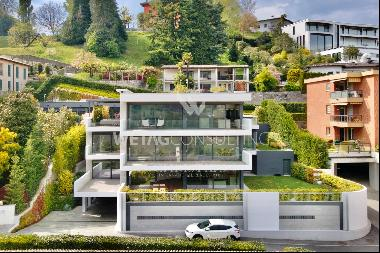 Montagnola: modern 5.5-room apartment with Lake Lugano view for sale