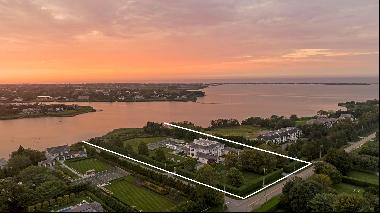 The pinnacle in luxury, this one-of-a-kind world class waterfront estate boasts over 4 acr