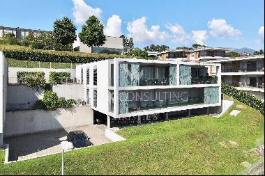 Modern penthouse apartment with terrace & wonderful lake view for sale in Lugano