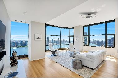 Sophisticated and sun-drenched, this corner three-bedroom, three bathroom luxury condomini