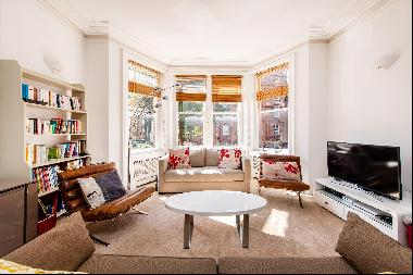 A 4 bedroom lateral apartment in Canfield Gardens NW6