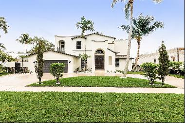 Spacious waterfront home features 80 feet of water frontage, 20,000 lb lift, new AC, light