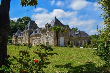 Elegant manor set on nearly 2.5 acres of landscaped park near a medieval city