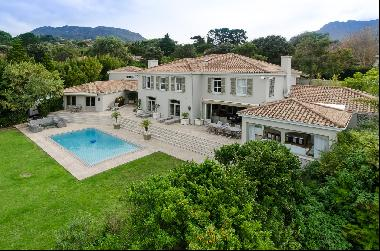A beautifully aesthetic and distinctive home with magnificent views set on an acre of lan