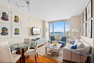 Perched high among the clouds, this luxury two-bedroom, two-bathroom condo features sweepi