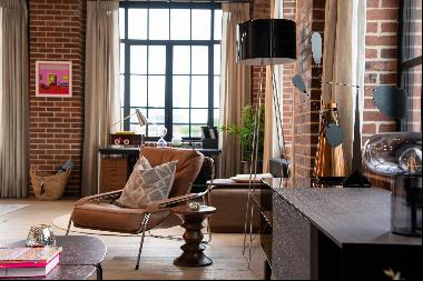 A third floor, dual aspect, 96 sqm loft apartment in a warehouse style building with expos