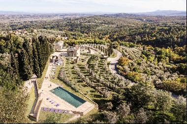 Partially restored historic villa complex dominating the hills of Southern Tuscany.